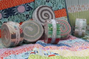 Selection of Jelly Rolls and completed quilts